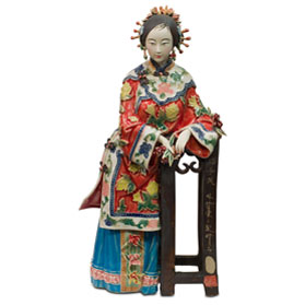 Chinese Porcelain Figurine, Shi Wan Lady in Red Leaning on Pedestal