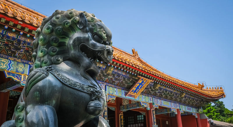 Foo Dog Statue in Front of Chinese Palace
